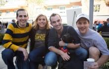 Adam Bethke, Jess Fern, Tim Savoy, and Peter Konwerski pose at the block party.